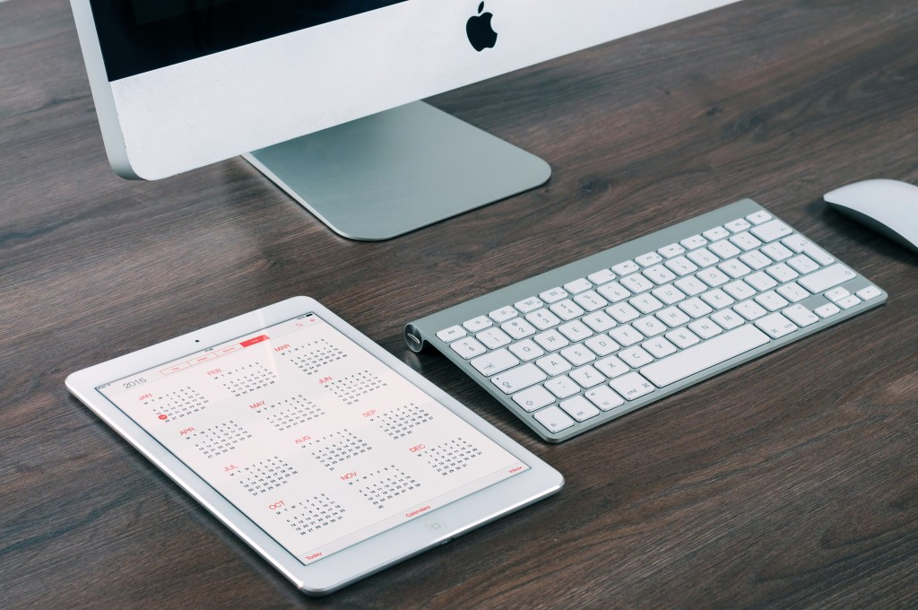 Computer and iPad with calendar